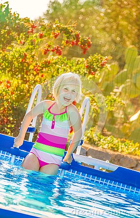 Free Happy Healthy Child In Swimwear Standing In Swimming Pool Stock Photo - 90234740