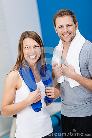 Happy healthy couple at the gym