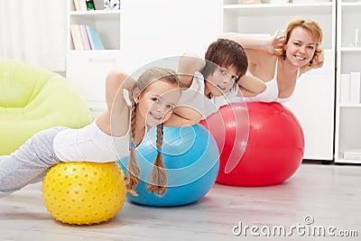 Happy healthy family exercising