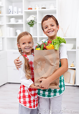Happy healthy kids with the grocery bag