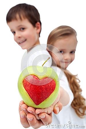 Happy healthy kids holding apple