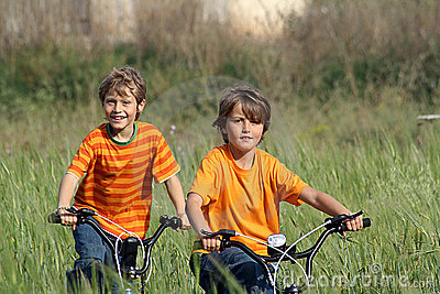 happy healthy kids riding bikes