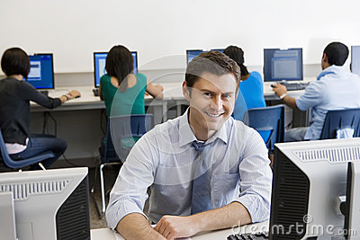 Happy High School Teacher In Computer Lab