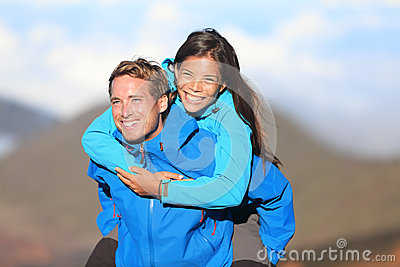 Happy hiking couple piggyback