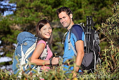 Happy hiking friends / couple hikers in forest