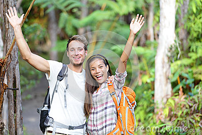 Happy hiking - hikers cheering joyful in forest