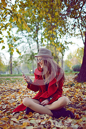 Happy hipster girl with cell phone
