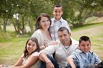 Happy Hispanic Family In the Park