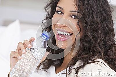 Happy Hispanic Woman Drinking Bottle of Water
