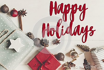 Happy holidays text, seasonal greetings card sign. christmas fla Stock Photo