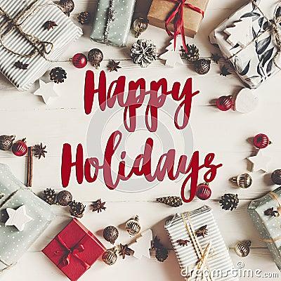 Happy holidays text, seasonal greetings card sign. christmas fla Stock Photo