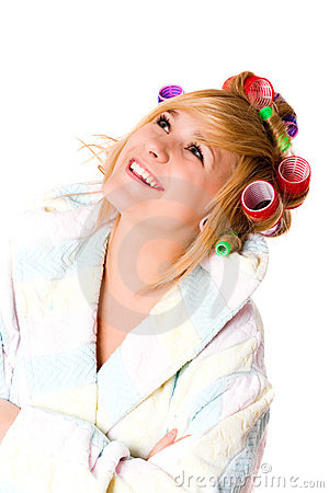 Happy housewife with curlers