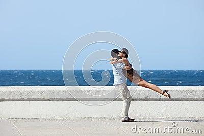 Happy hug between beautiful wife and husband