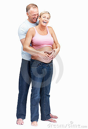 Happy husband embracing his pregnant wife