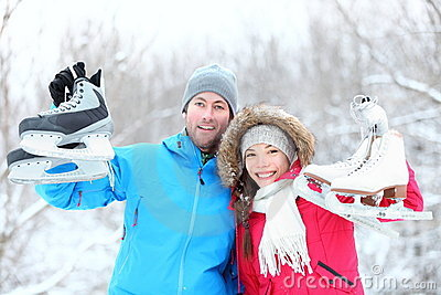 Happy ice skating winter couple