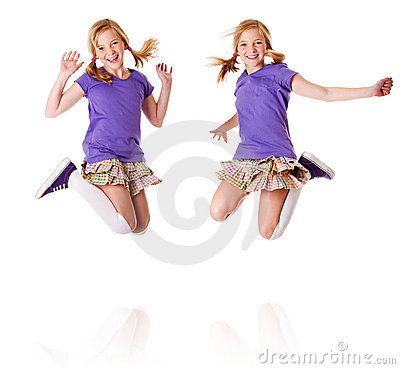 Free Happy Identical Twins Jumping And Laughing Royalty Free Stock Image - 20104936
