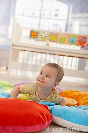 Happy infant on playmat