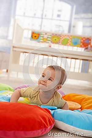 Happy infant on playmat