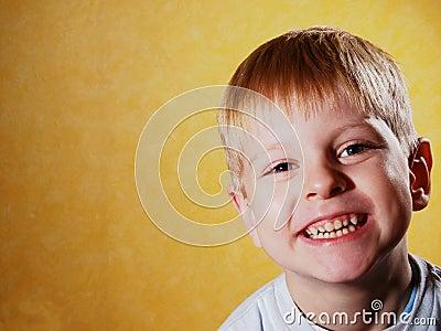 Happy joyful beautiful little boy