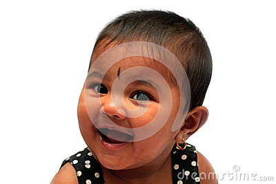 Happy & joyful healthy indian baby girl smiling