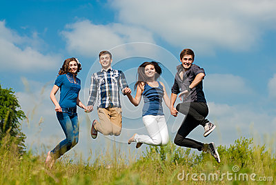 Happy jump: group of Young people outdoors