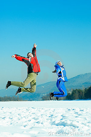 Happy jumping couple