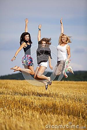 Happy jumping teenage girls