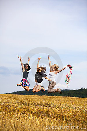 Happy jumping teenage girls