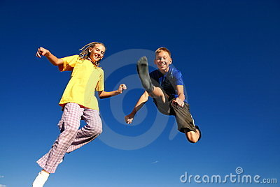 Happy jumping teens