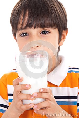 Happy kid drinking glass of milk