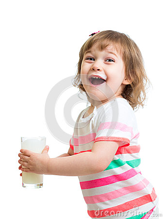 Happy kid drinking milk from glass. Isolated