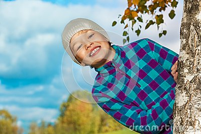 Happy kid jumping out of tree