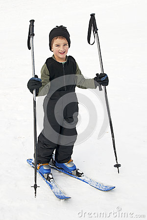Free Happy Kid Learning To Ski Royalty Free Stock Photos - 29089978