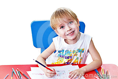 Happy kid with pencils