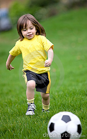 Happy kid playing football
