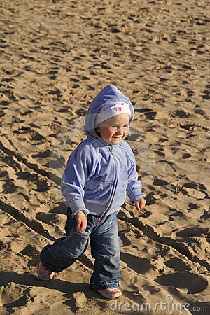 Happy kid on the sand beach