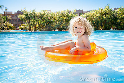 Happy kid swimming in pool