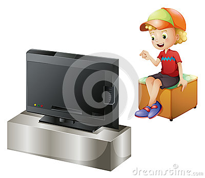 A happy kid watching TV