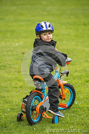 Free Happy Kid With Bike In Park Royalty Free Stock Images - 55468289