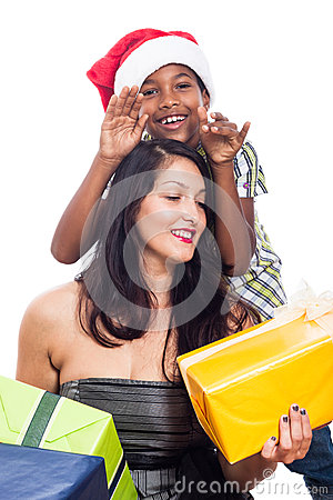 Happy kid and woman with Christmas presents