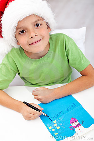 Happy kid writing letter to santa