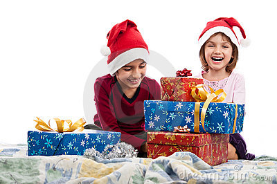 Happy kids in bed with Christmas presents isolated