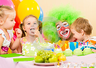 Happy kids celebrating birthday party with clown