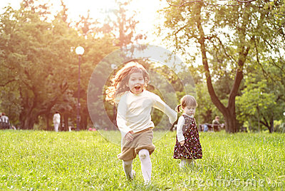 Happy kids have fun  outdoors  in the park