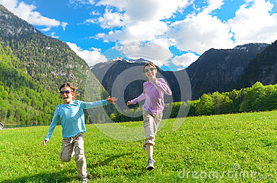 Happy kids having fun and running outdoors