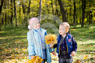 Happy kids playing in autumn woodland