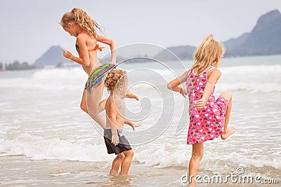 Happy kids playing on beach