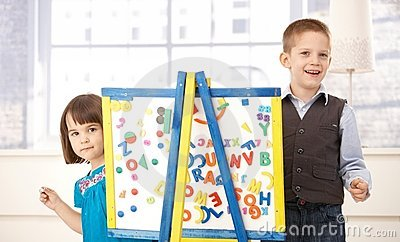 Happy kids playing with drawing board