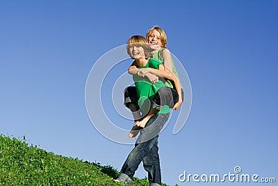 Happy kids playing piggyback