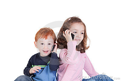 Happy kids talking on mobile phones